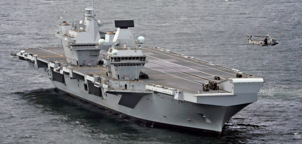 Pictured during sea trails, is an aerial view of HMS Queen Elizabeth, HMS Sutherland and HMS Iron Duke as well as a Fleet Air Arm Merlin helicopter. HMS Queen Elizabeth left Rosyth, where she has been under construction since 2014, to conduct sea trials. Type 23 frigates Sutherland and Iron Duke joined the 65,000-tonne aircraft carrier, along with Merlin Mk2 helicopters of the Fleet Air Arm, to guard the seas as the trials get under way. The Queen Elizabeth Class Carriers are the biggest warships ever built for the Royal Navy - four acres of sovereign territory, deployable across the globe to serve the United Kingdom on operations for 50 years. HMS Queen Elizabeth and HMS Prince of Wales will be the most advanced warships in the Royal Navy fleet. They are the future flagships of the nation. Initially the ships will carry helicopters. The vast flight deck and hangar can accommodate any helicopter in Britain's military inventory. From 2020, however, our punch will be delivered by the F35 Lightning II, the world's most advanced stealth fighter-bomber.